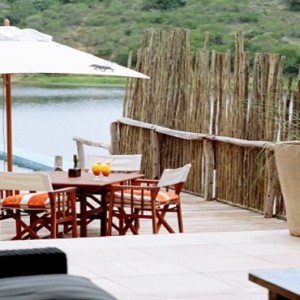 Pumba Private Game reserve - Luxury South Africa Honeymoon Packages - Water Lodge pool and lake view