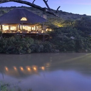 Shamwari Game Reserve - Luxury South Africa Honeymoon Packages - Bayethe Tented lodge river