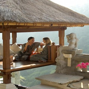 Bali Honeymoon Packages Viceroy Bali Couple Sitting In Cabana In Villa