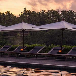 Bali Honeymoon Packages Alila Ubud Pool Sun Loungers At Sunset