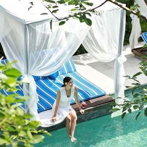 Bali Honeymoon Packages The Elysian Seminyak Women Relaxing On Pool Cabana