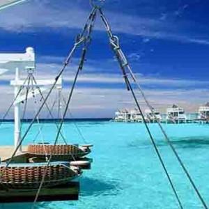 Centara Grand Island Resort & Spa - Luxury Maldives Honeymoon Packages - Aqua exterior lounge seats