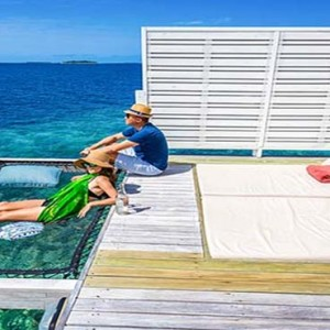 Centara Grand Island Resort & Spa - Luxury Maldives Honeymoon Packages - Deluxe water villa sun lounge