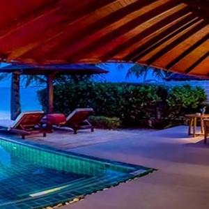 Centara Grand Island Resort & Spa - Luxury Maldives Honeymoon Packages - Luxury Beachfront Pool Villa 1 Bedroom pool at night