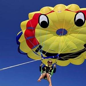 Centara Grand Island Resort & Spa - Luxury Maldives Honeymoon Packages - Paragliding