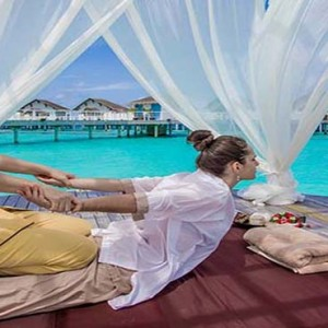 Centara Grand Island Resort & Spa - Luxury Maldives Honeymoon Packages - Spa massage open-air