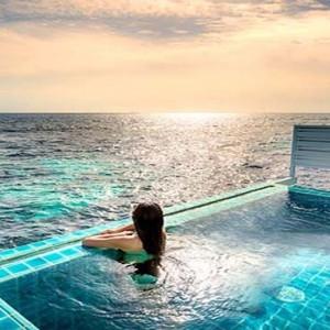 Centara Grand Island Resort & Spa - Luxury Maldives Honeymoon Packages - Sunset Ocean Pool Villa woman in pool