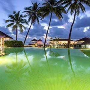 Centara Grand Island Resort & Spa - Luxury Maldives Honeymoon Packages - The club exterior at night
