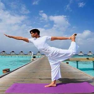 Centara Grand Island Resort & Spa - Luxury Maldives Honeymoon Packages - Yoga open-air
