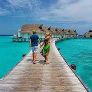 Centara Grand Island Resort & Spa - Luxury Maldives Honeymoon Packages - overwater villa walkway