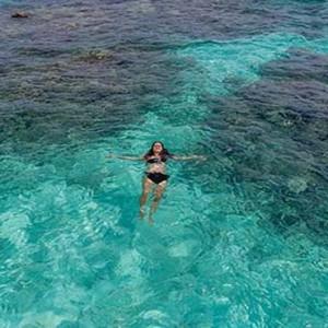 Centara Grand Island Resort & Spa - Luxury Maldives Honeymoon Packages - swimming in lagoon