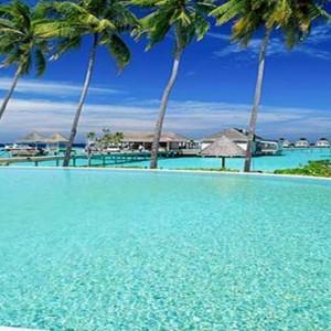 Centara Grand Island Resort & Spa - Luxury Maldives Honeymoon Packages - the club pool