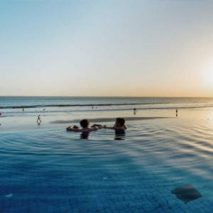 Legian Bali Seminyak - Luxury Bali Honeymoon Packages - couple in the pool