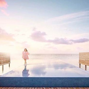 Lux South Ari Atoll - Luxury Maldives Honeymoon Packages - Temptation Pool Water Villa pool sunset