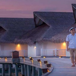 Centara Grand Island Resort & Spa - Luxury Maldives Honeymoon Packages - Couple going for a stroll on boardway