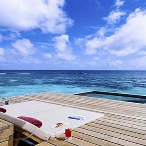 Centara Grand Island Resort & Spa - Luxury Maldives Honeymoon Packages - Ocean Water Villa ocean deck hammock