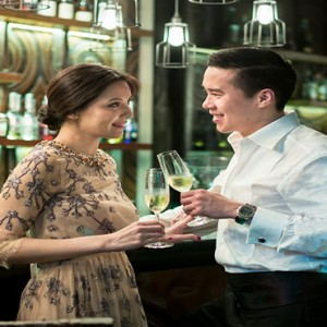 Keemala Phuket - luxury Thailand Honeymoon Packages - Couple having drinks at the bar