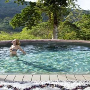Keemala Phuket - luxury Thailand Honeymoon Packages - Women in tree house pool