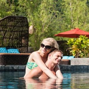 Keemala Phuket - luxury Thailand Honeymoon Packages - couple in pool