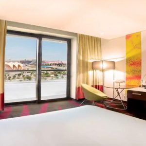 Abu Dhabi Honeymoon Packages Radisson Blu Hotel, Abu Dhabi Yas Island Superior Room With Balcony Race Track View