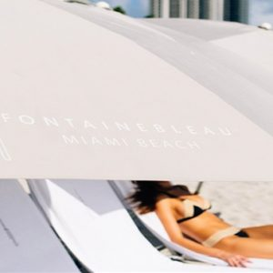 Woman Relaxing On Beach Fontainebleau Miami Beach Miami Honeymoons