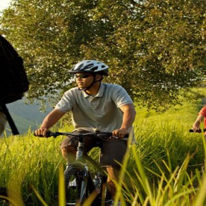 Bali Honeymoon Packages COMO Uma Ubud Biking Through Rice Fields
