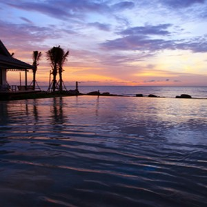 Thailand Honeymoon Packages Devasom Hua Hin Resort Pool View At Sunset