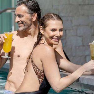Cyprus Honeymoon Packages Amavi Hotel Cyprus Couple Drinking In Saffire Pool