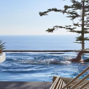 Greece Honeymoon Packages Myconian Utopia Man Swimming In Pool
