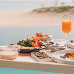 Maldives Honeymoon Packages LUX North Male Atoll Dining By The Pool1