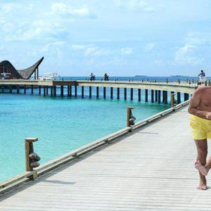 Maldives Honeymoon Package Joali Maldives Bike Riding On Jetty