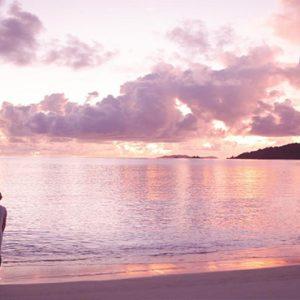 Maldives Honeymoon Packages Raffles Maldives Meradhoo Couple On Beach At Sunset