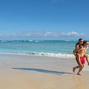 Dominican Republic Honeymoon Packages Breathless Punta Cana Resort & Spa Couples On Beach