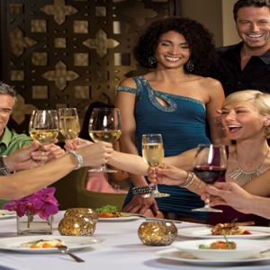 Dominican Republic Honeymoon Packages Breathless Punta Cana Resort & Spa Friends Toasting At The Coquette Restaurant
