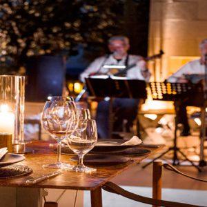 Greece Honeymoon Packages Amanzoe Pool Restaurant At Night