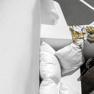 Greece Honeymoon Packages Chromata Hotel Santorini Seating White Walls