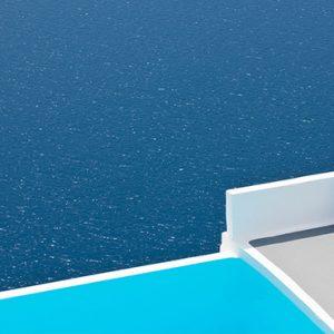 Greece Honeymoon Packages Chromata Hotel Santorini Woman Looking At Views1