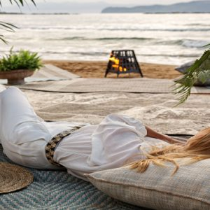 Greece Honeymoon Packages Domes Noruz Chania Woman Relaxing On Beach