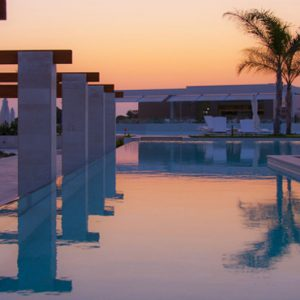 Greece Honeymoon Packages Avra Imperial Pool At Sunset