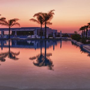 Greece Honeymoon Packages Avra Imperial Pool At Sunset1