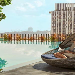 Singapore Honeymoon Packages Oasia Hotel Downtown Women In Cabana By The Pool