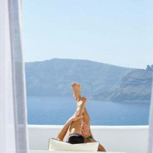 Greece Honeymoon Packages Kirini Santorini Women Relaxing On Balcony