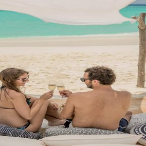 Maldives Honeymoon Packages Fushifaru Relaxing And Drinking On Sandbank