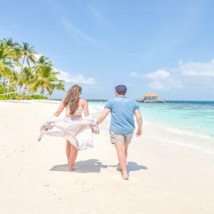 Maldives Honeymoon Packages Reethi Faru Resort Couple On Beach