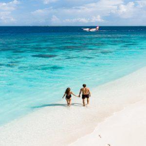 Maldives Honeymoon Packages Reethi Faru Resort Couple On Beach1
