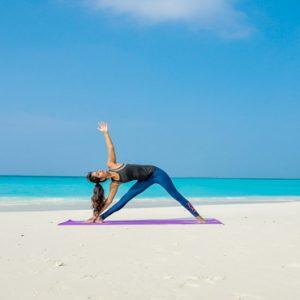 Maldives Honeymoon Packages Reethi Faru Resort Yoga On The Beach