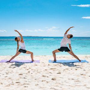 Maldives Honeymoon Packages Reethi Faru Resort Yoga On The Beach1