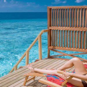 Maldives Honeymoon Packages Women Relaxing In Water Villa