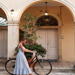 Greece Honeymoon Packages Domes Miramare, Corfu Woman Cycling