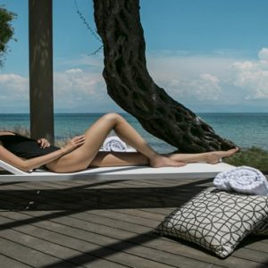 Greece Honeymoon Packages Domes Miramare, Corfu Woman Relaxing